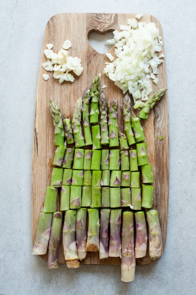 trimmed asparagus on a wooden board