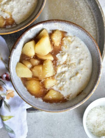 coconut oatmeal with syrupy pears in a grey bowl