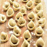 uszka (little dumplings) on a wooden board
