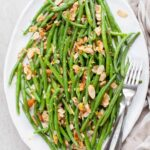 green beans almondine in a large white plate