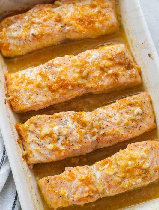 Orange maple salmon in a white baking dish.