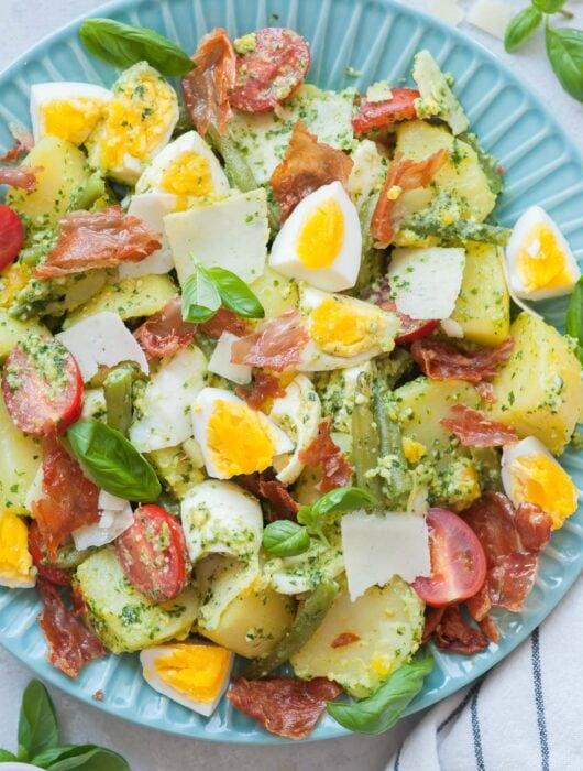 Pesto potato salad on a blue plate.